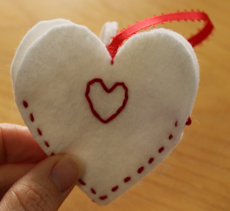 Ornament using three hearts.