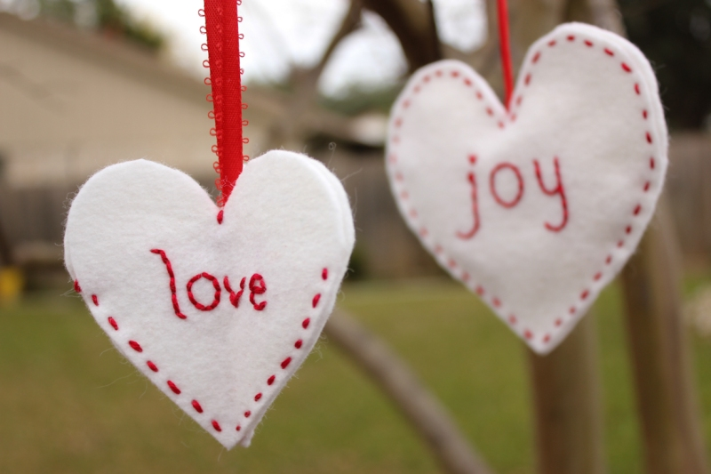 Embroidered ornaments, one uses 3 hearts and the other uses 2 hearts.