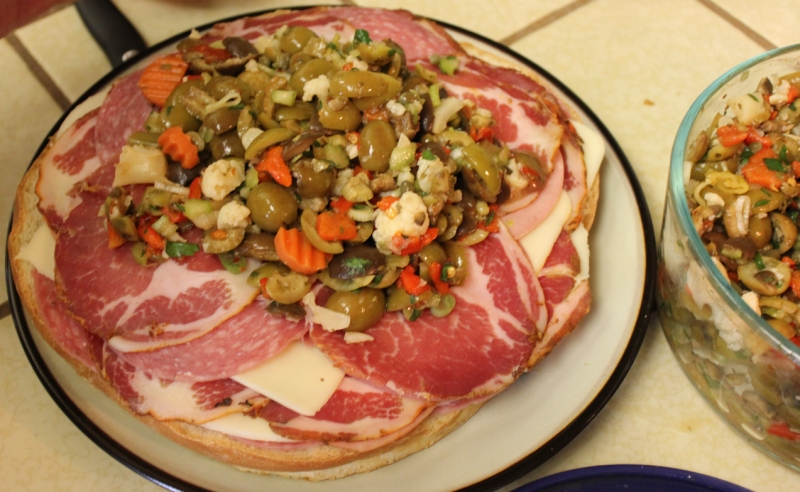 Start of the meat muffuletta. In the end, it had waaaaay more olive salad on top.