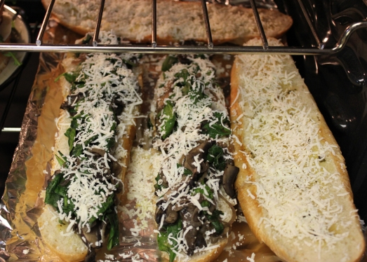 Portobello, spinach, shallot, roasted garlic and cotija cheese sandwiches.