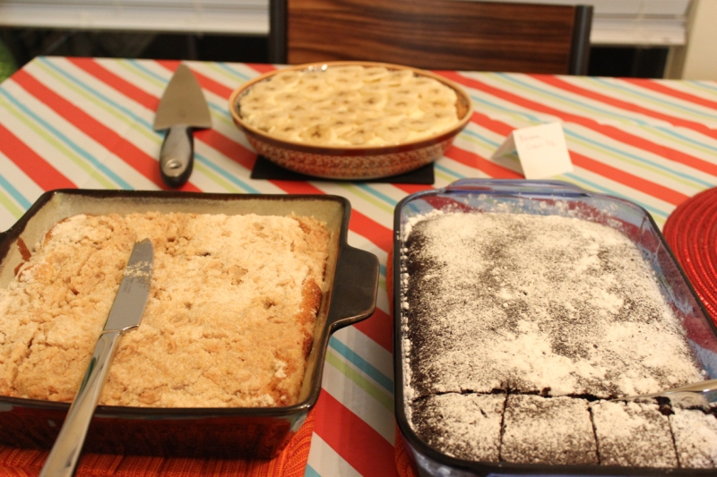 Blueberry crumble cake (bottom left), banana cream pie (top), chocolate crazy cake (bottom right)