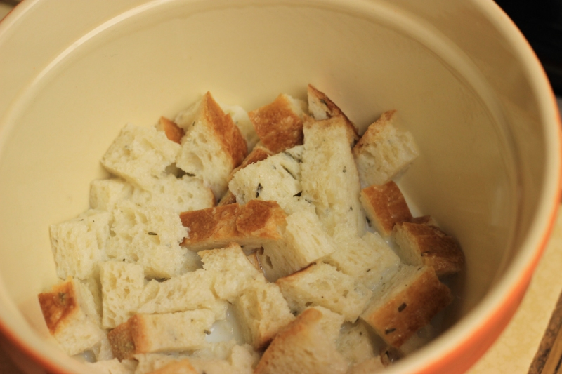 Pour the milk on the bread cubes and let it soak a bit.