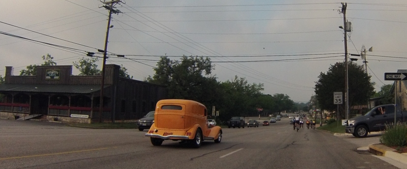 Classic cars, rolling down the main street in Blanco right after the ride started.