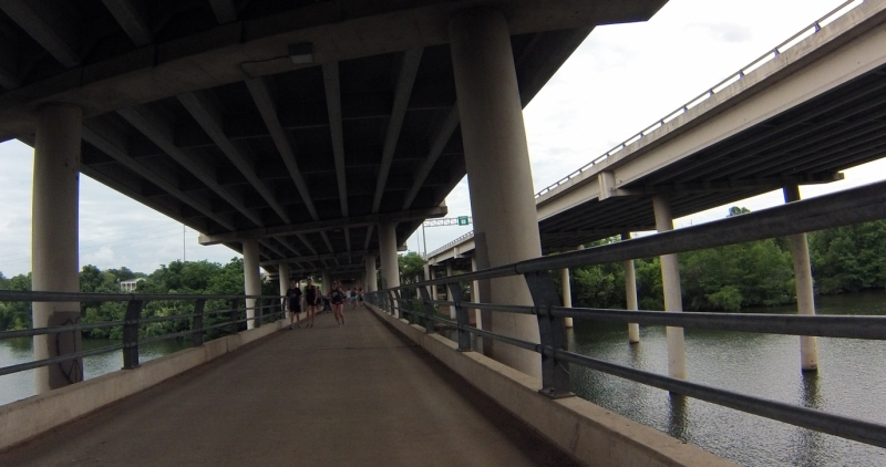 Crossing the pedestrian bridge under Mopac.