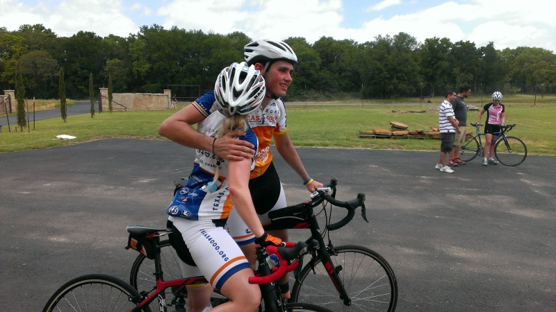 Two Texas 4000 riders congratulate each other at the finish.