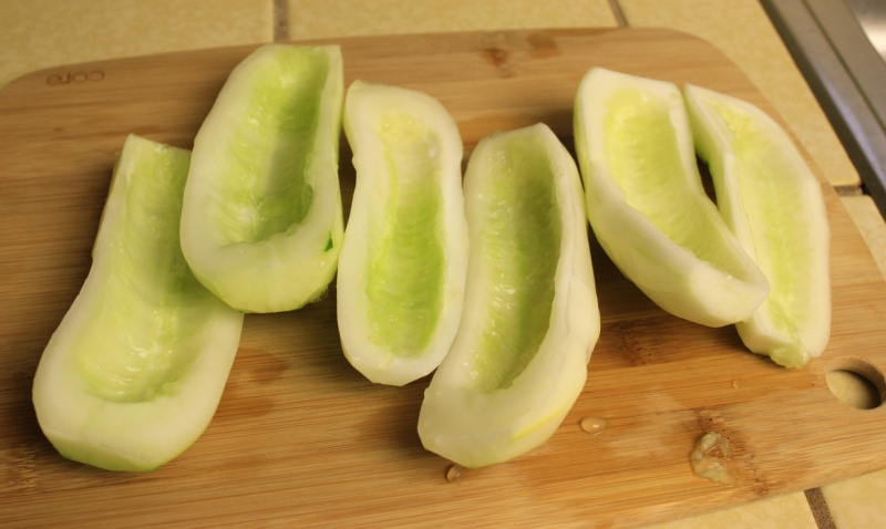 Peel and seed cucumbers