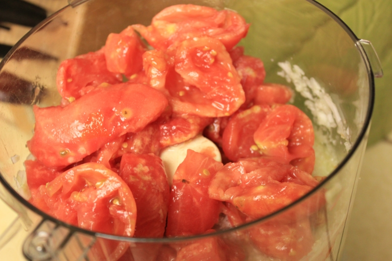 Add peeled and seeded tomatoes to the food processor and combine.